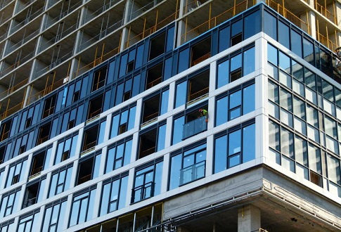 Zig Zag Cladding Starting as Grid Condo Rises Taller